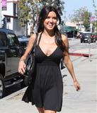 Audrina Patridge in cleavagey black dress shows pokies while shopping in Sushi Roku