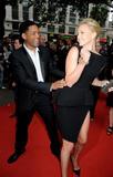 Charlize Theron shows legs wearing deep slit black dress Hancock UK Premiere in London